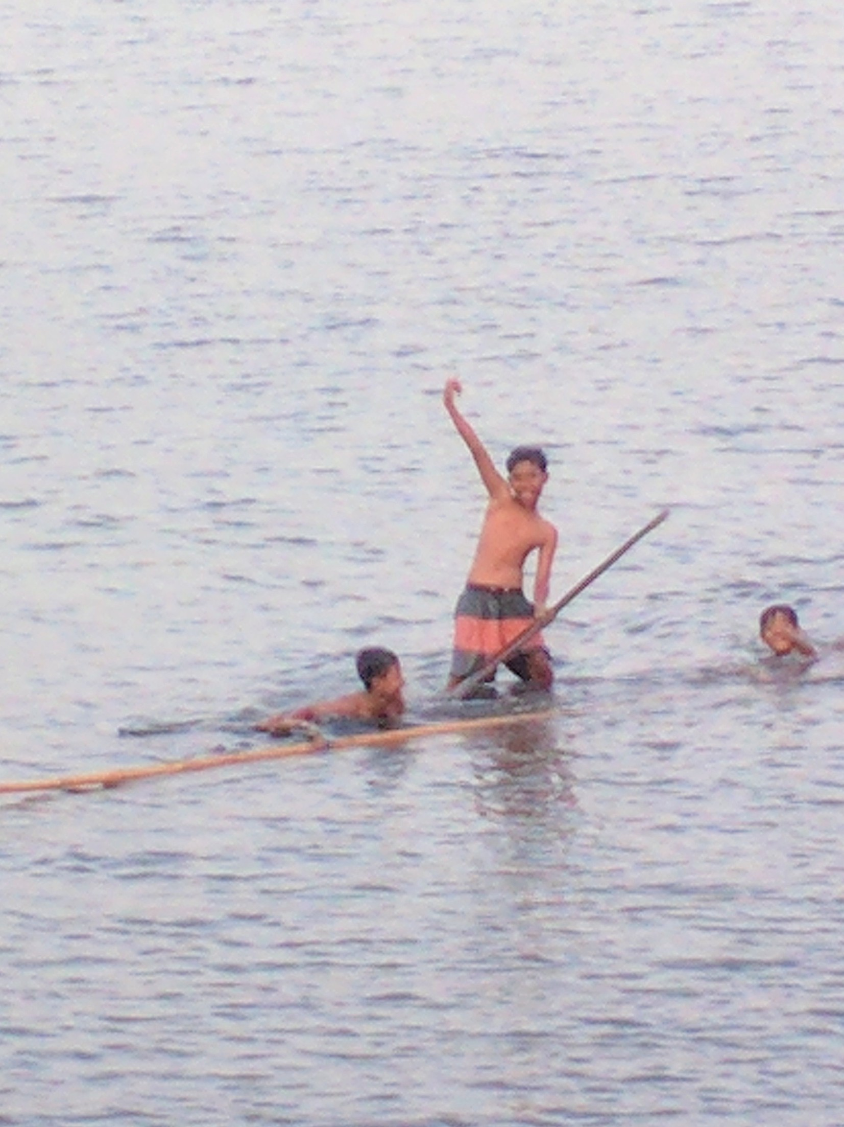 Boys in canoes hamming it up for the camera